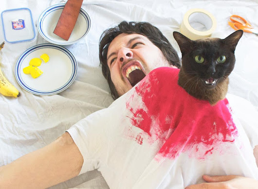 A Silly Human Hilariously Poses With His Beloved Cats to Recreate Famous Movie Scenes