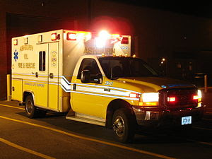 An American ambulance also with all its lights...