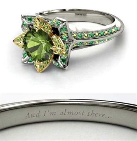 Tiana Engagement Ring. It is a lotus flower!   Disney