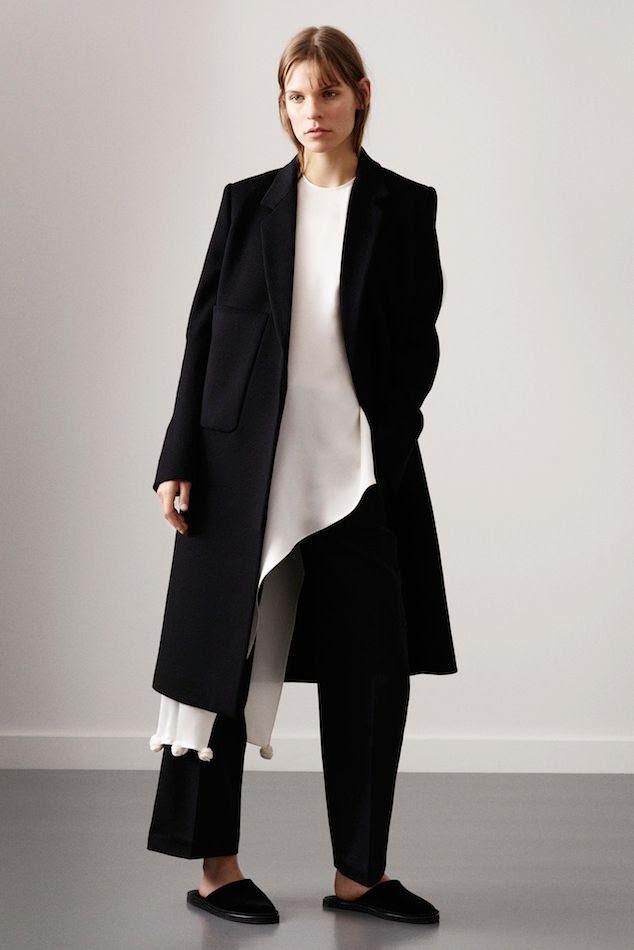 Le Fashion Blog Ports 1961 FW 2015 Minimal Long Black Coat White Asymmetrical Top With Pom Pom Hem Cropped Pants Slippers photo Le-Fashion-Blog-Ports-1961-FW-2015-Minimal-Long-Black-Coat-White-Asymmetrical-Top-With-Pom-Pom-Hem-Cropped-Pants-Slippers.jpg