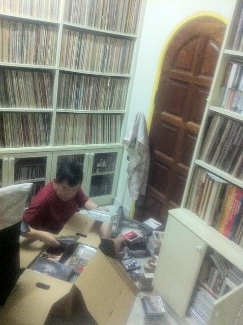 Dad going through Zeg Zeg's record collection