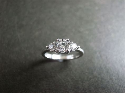 3 stone engagement ring but with diamonds around the band