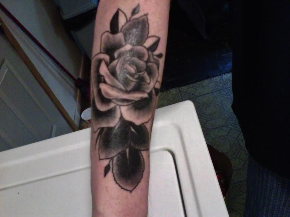 Black Rose Tattoo On Arm