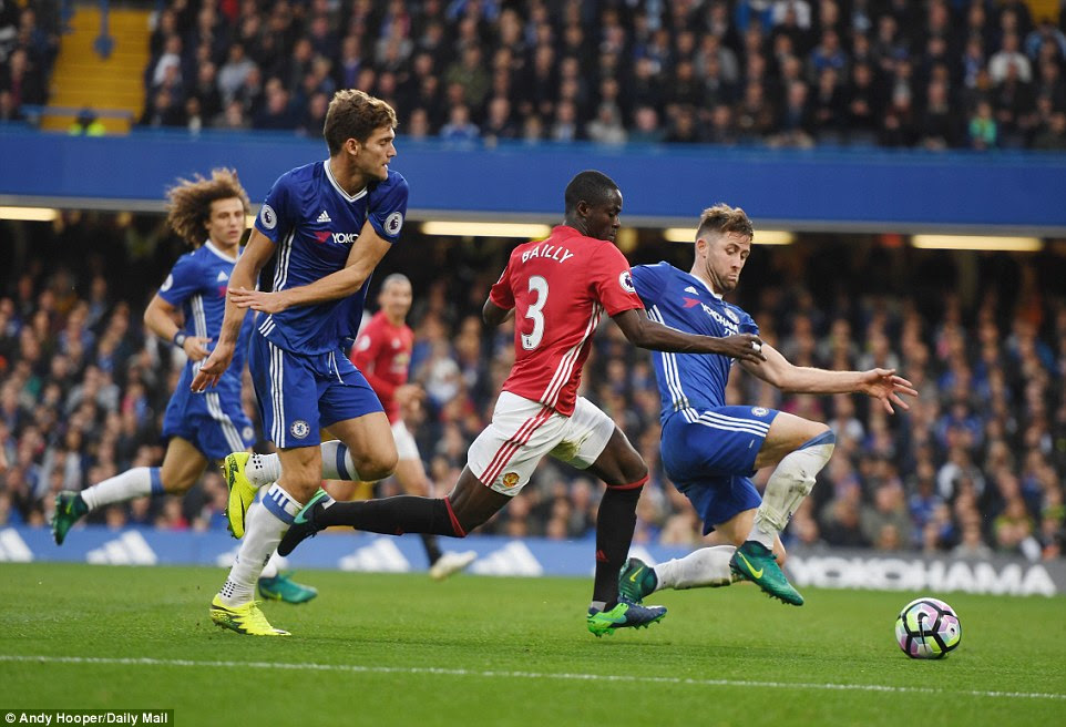 Chelsea defender Cahill (right) stops  Eric Bailly in his tracks with a tackle
