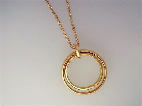 Gold ring pendant using two wedding bands. A commission to