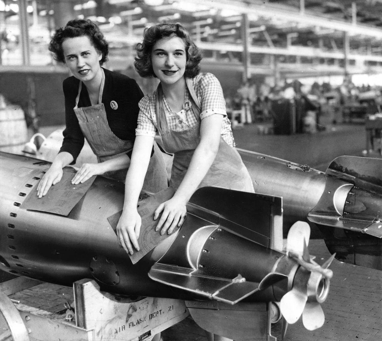 Mrs. Lenore Radway, left, and Miss Sherley Becker polish a torpedo flask in 1943 at the Amertorp Torpedo Ordnance Corporation in Forest Park, Illinois. As many as 6,500 workers churned out hundreds of torpedoes per month, a long-forgotten but crucial part of the war effort.