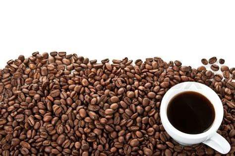 Coffee beans and cup isolated on a white background