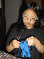 Olivia Cleaning Glasses to Donate
