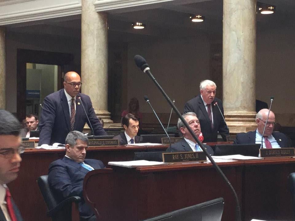 Sen. Reginald Thomas, D-Lexington, left, and Sen. Albert Robinson, R-London, debated a bill that would let businesses reject gay customers on religious grounds.
