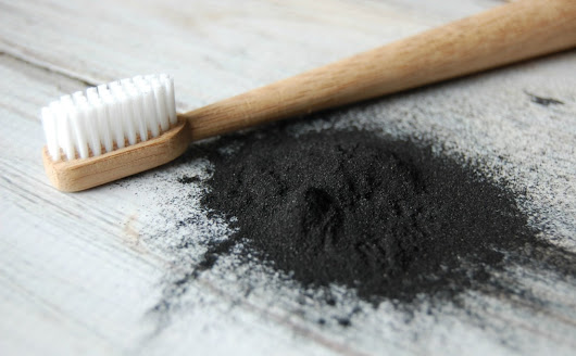 How to Naturally Whiten Your Teeth with Activated Charcoal - The Pistachio Project