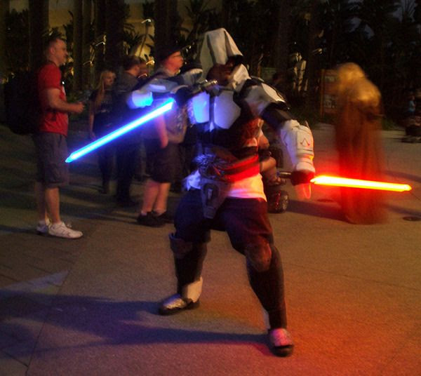 A lightsaber-welding assassin from ASSASSIN'S CREED poses for photos at the Star Wars Celebration in Anaheim, California...on April 17, 2015.