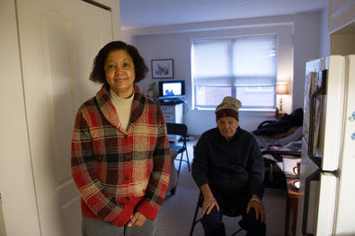 Cheryl Delaney, a caregiver at an assisted-living facility in Brookline, Mass., with a client, Tullius Acampora.