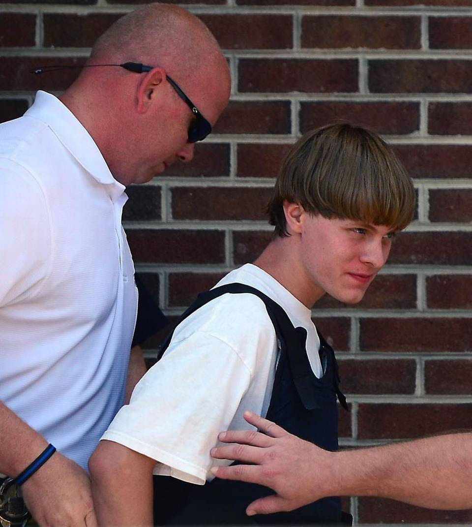 Charleston shooting suspect Dylann Roof is escorted from the Shelby Police Dept. Thursday, June 18, 2015.