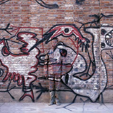 Liu Bolin, City Hiding 84 - Graffiti