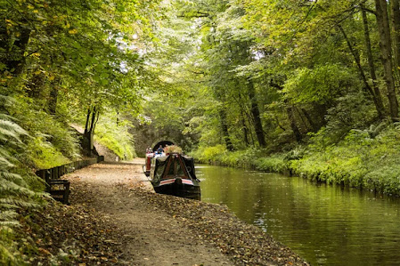 Narrowboat waits to navigate Chirk Canal Tunnel — Stock Photo © perrynb #126484508