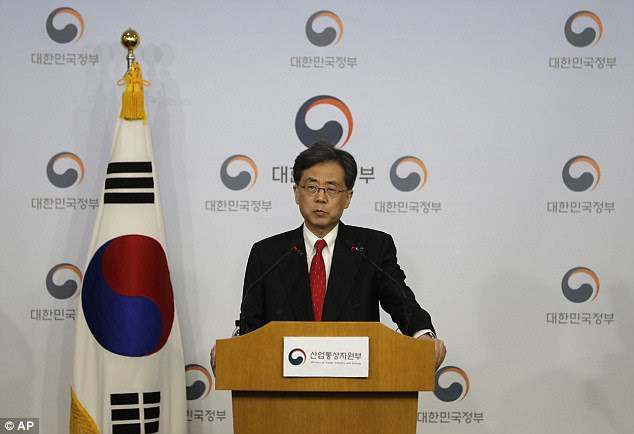 South Korean Trade Minister Kim Hyun-chong listens to a reporter's question during a briefing at Foreign Ministry in Seoul, South Korea regarding the deal