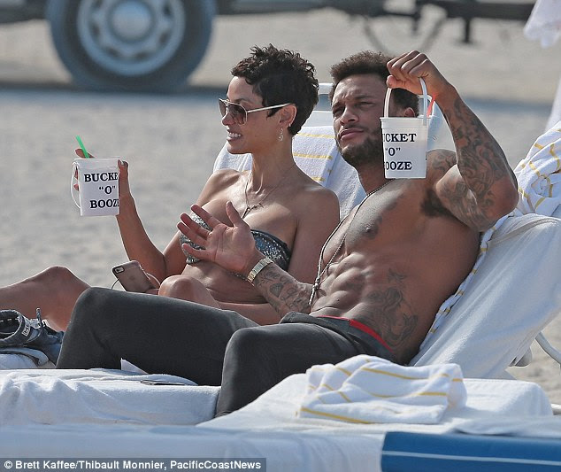 A little R&R: Nicole Murphy and David McIntosh were seen lounging together with large drinks in their hands at a Miami beach on Saturday