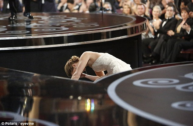 Another mishap for Jennifer: She can't quite believe she has ended up on her knees at the Academy Awards
