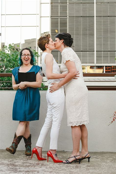 Colorful outdoor rooftop lesbian wedding in Austin, Texas