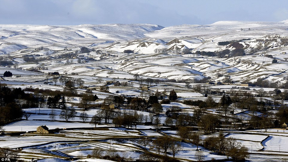 Picture perfect: This was the scene inTeesdale, County Durham, today as freezing temperatures meant that yesterday's snow stayed scattered on the fields and farmhouses