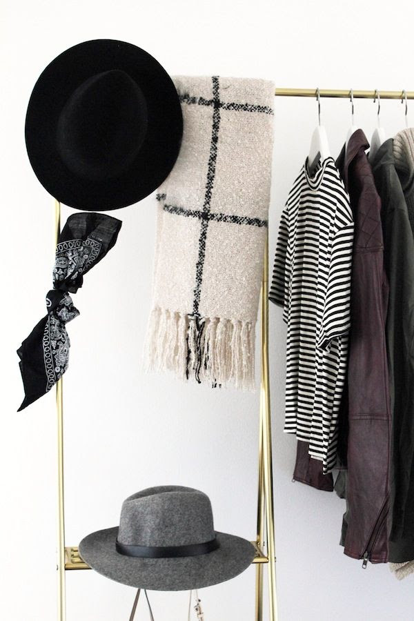 Le Fashion Blog Open Closet Inspiration Gold Clothes Rack Fedora Hat Grid Print Scarf Striped Mock Neck Top Burgundy Leather Jacket Bandana Home Decor Jenn Camp