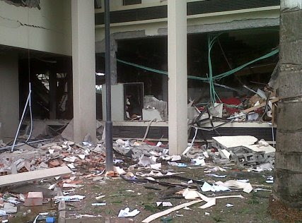 This image released by Saharareporters shows debris after a large explosion struck the United Nations' main office in Nigeria's capital Abuja Friday Aug. 26, 2011, flattening one wing of the building
