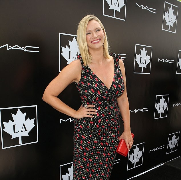 a767b8de7323b She's the cherry on the pie! Natasha Henstridge shows off curves in  plunging wrap dress at Golden Maple Awards in LA | Of course it's hard.