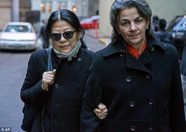Sheri Yan, 60,the head of the Global Sustainability Foundationhas admitted bribing a U.N. official with cash, Rolexes and BMWs in return for influence. She is pictured, left, outside a court in New York on Thursday