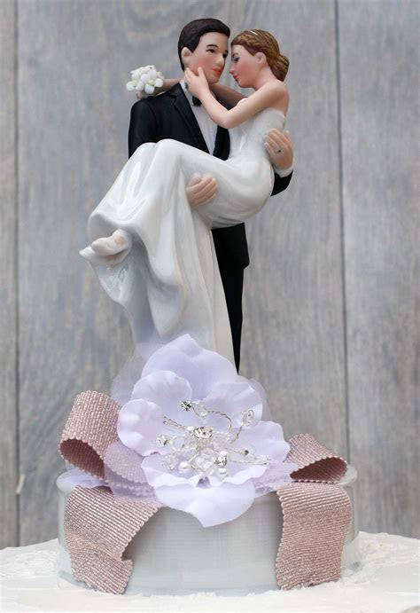 Ribbon Accent Groom Holding the Bride Wedding Cake Topper