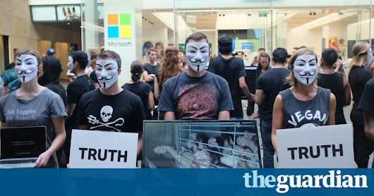 'Cube of truth': Anonymous hit streets with violent footage of animal farming | World news | The Guardian
