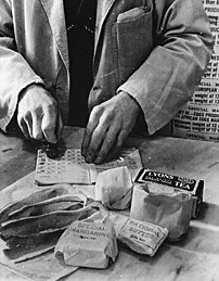A shopkeeper cancels the coupons in a British ...