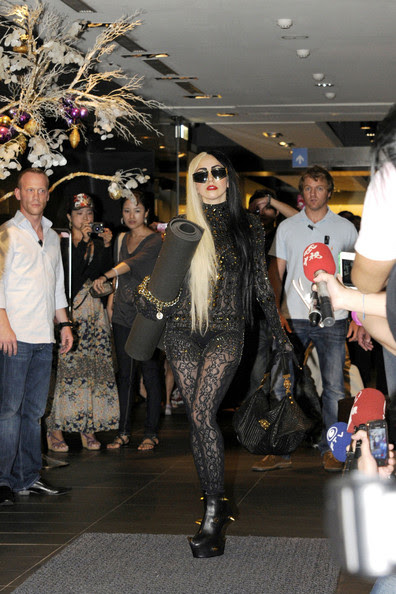 "Lady Gaga wears a black and gold themed outfit coordinated with her yoga mat as she leaves a yoga class in downtown Taipei. The pop superstar, whose visit reportedly attracted nearly 500 onlookers, is in Taiwan to promote her new album ""Born This Way"". Gaga arrived at Pure Yoga at around 3pm and stayed for a 1 hour session."