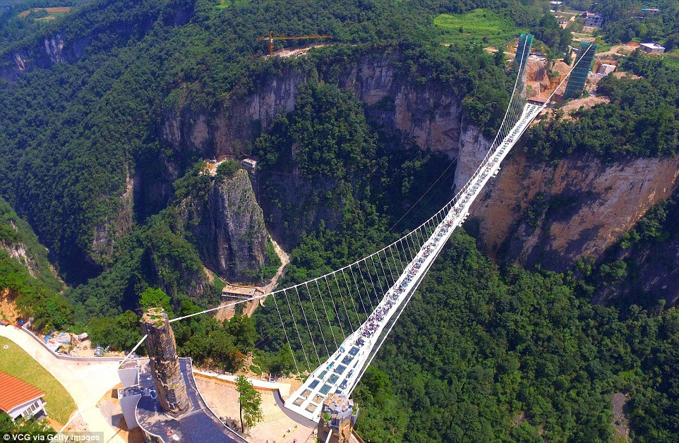 Head for heights: Aerial view photo shows the glass-bottom bridge at Zhangjiajie Grand Canyon