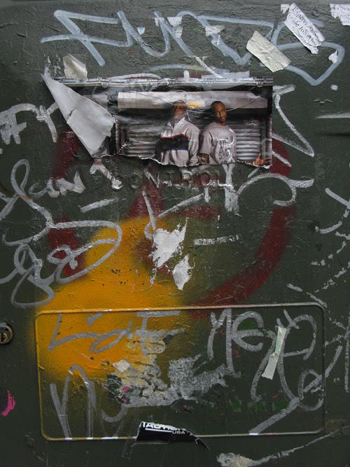 graffiti and ripped photo, Manhattan, NYC