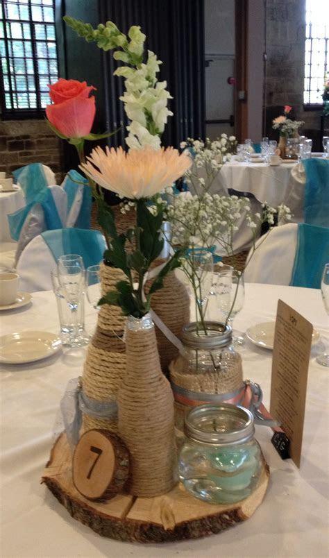 Rustic Wedding Centerpiece. Twine wrapped wine bottles