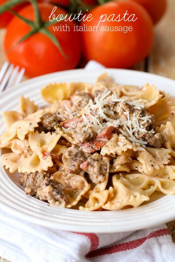 Italian Sausage with Bowtie Pasta - easy and delicious! { lilluna.com } Recipe includes bow tie pasta, Italian sausage, garlic, parmesan cheese, and Italian stewed tomatoes.