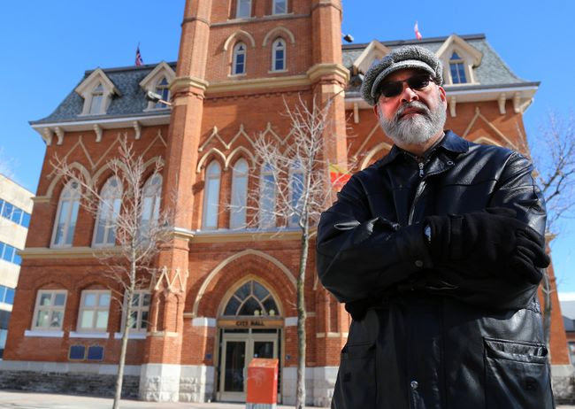 TIM MIller/The Intelligencer Rev. David Mundy stands in front of Belleville's city hall Thursday. Mundy, representing several local churches, has been denied the opportunity to speak in front of council in regards to concerns arising from the approval of a new casino.