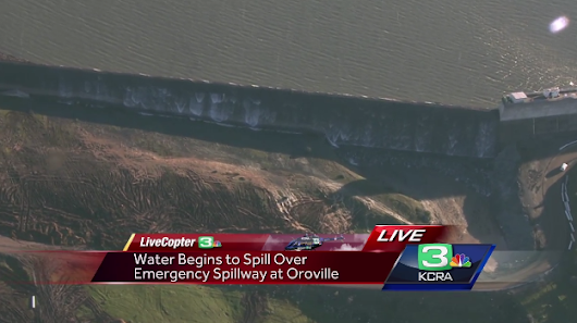 Water begins to spill over Oroville emergency spillway