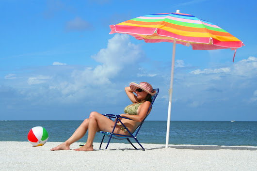 Beach umbrella vs. sunscreen. Which works better?