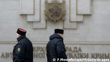guards stand in front of Crimea's regional parliament building in Simferopol on March 12 (Photo: FILIPPO MONTEFORTE/AFP/Getty Images)