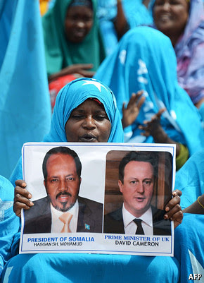 Poster held symbolizing the imperialist-backed conference in London to chart the future of the Horn of Africa nation of Somalia. The state has been a U.S. neo-colony under the current AMISOM and CIA occupation. by Pan-African News Wire File Photos