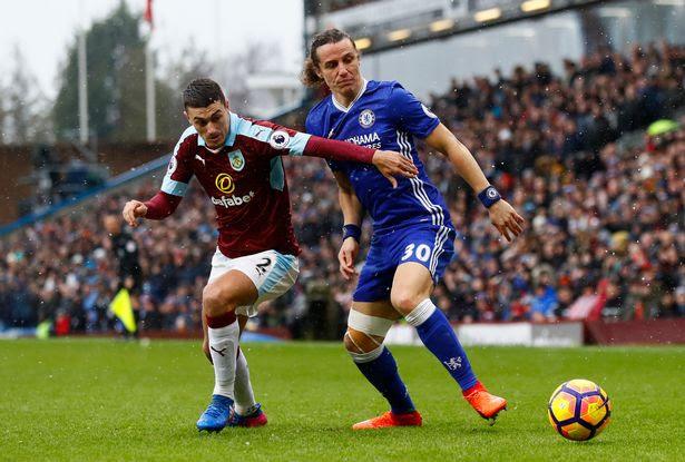 Burnley's Matthew Lowton in action with Chelsea's David Luiz