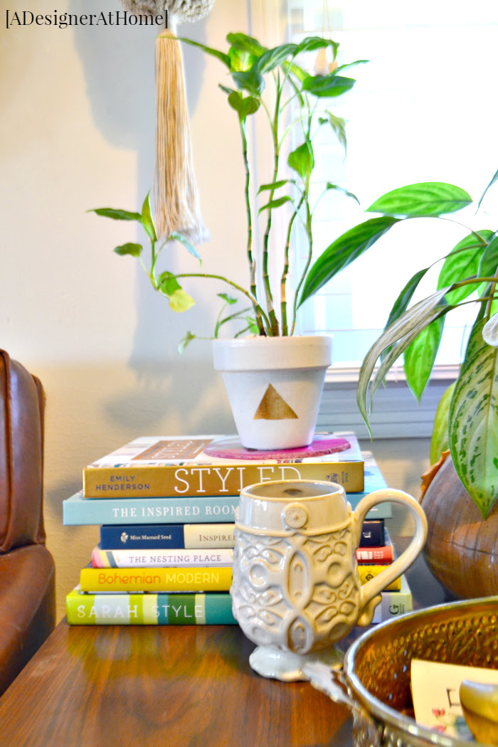 vintage-end-table-styled-with-design-books-plants-thrifted-treasures