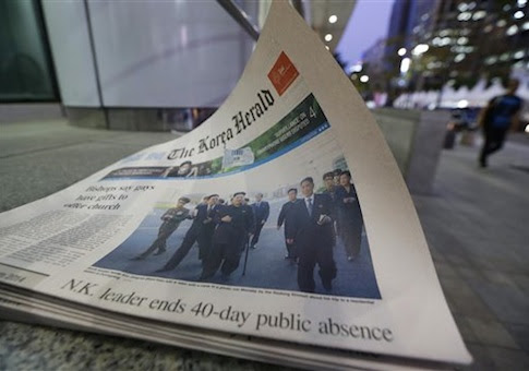 A photo of North Korean leader Kim Jong Un walking with a stick in Pyongyang, North Korea, is carried on the front page of a South Korea's English newspaper