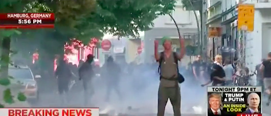 Instant Karma: G20 Protester Flips Cops The Double Bird -- Instantly Gets Tear Gassed Into Oblivion [VIDEO]