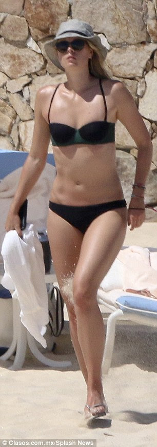 Stunning: She looked great in a black bikini with dark green accents