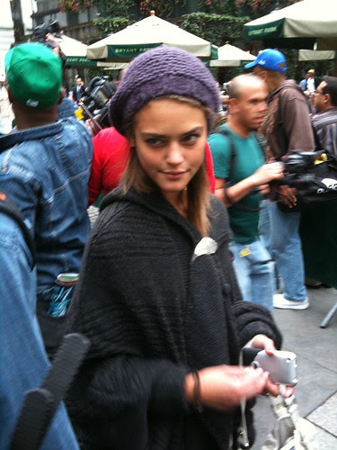 Holding pose despite paparazzi frenzy behind her