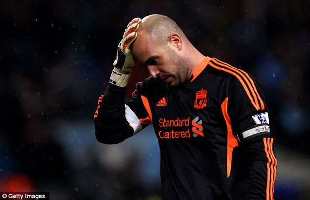 Head in hands moment: Pepe Reina allowed Aguero's shot to squirm under his body