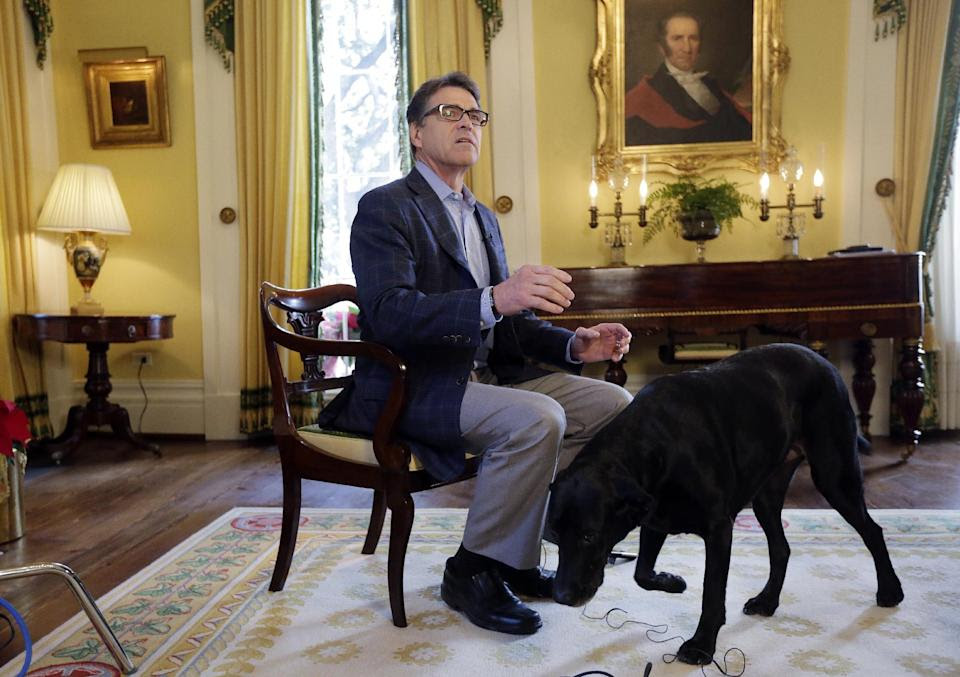 In this photo taken Dec. 9, 2014, Texas Gov. Rick Perry answers questions during an interview at the historic Texas Governor's Mansion in Austin, ...