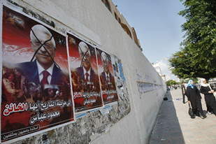 Palestinians in Gaza have put up posters criticizing Abbas for blocking international action against the state of Israel. by Pan-African News Wire File Photos